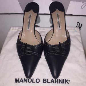 Black leather Manolo Blahnik mules, rolled tassels
